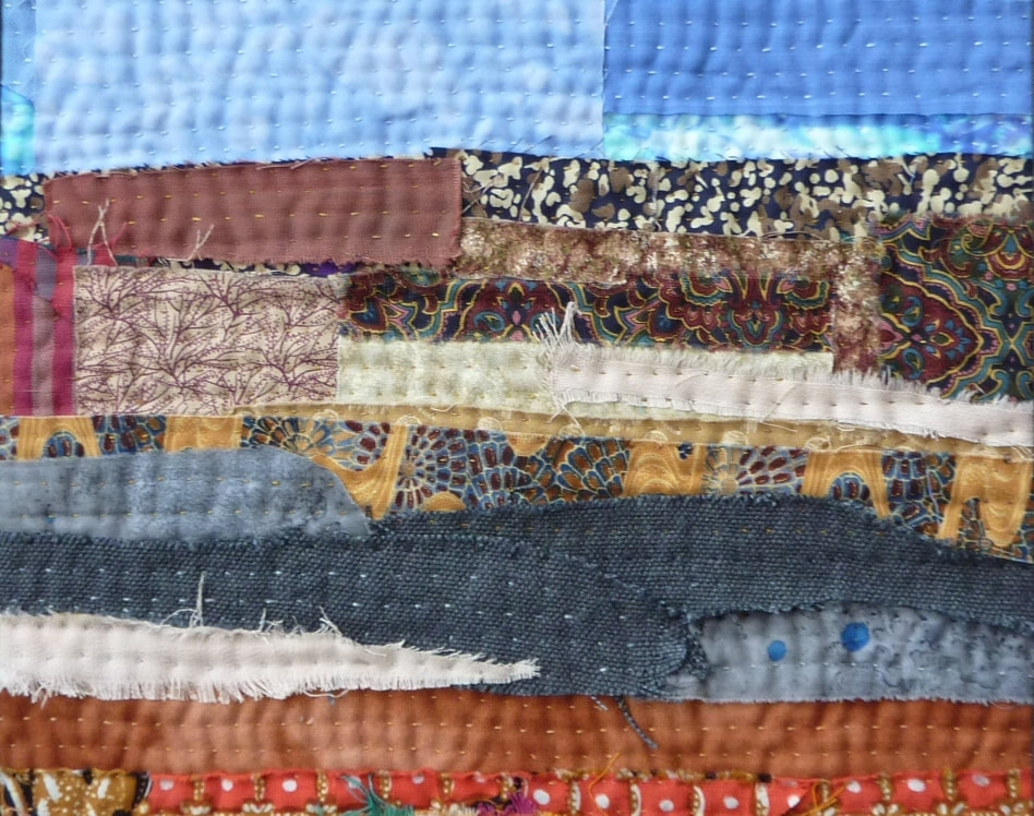 An art quilt featuring layers and strata forming an abstract landscape, inspired by The Lake District. This textile wall hanging features hand stitch and re-purposed textiles.